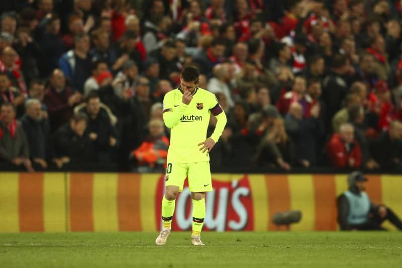 b3b0818fa4b Barcelona s Lionel Messi reasts as Liverpool s Georginio Wijnaldum  celebrates with teammates scoring his side s 2nd goal
