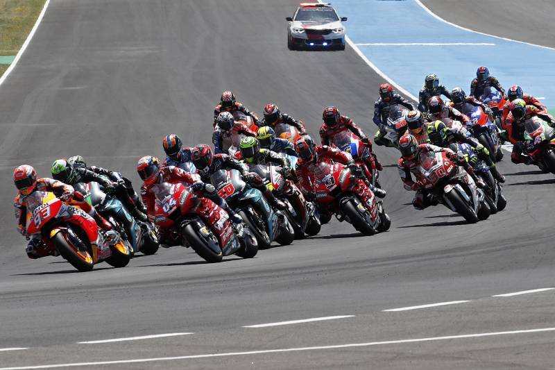 MotoGP rider Marc Marquez of Spain, left, leads the race during the Spanish Motorcycle Grand Prix at the Angel Nieto racetrack in Jerez de la Frontera, Spain, Sunday, May 5, 2019. (AP Photo/Miguel Morenatti)
