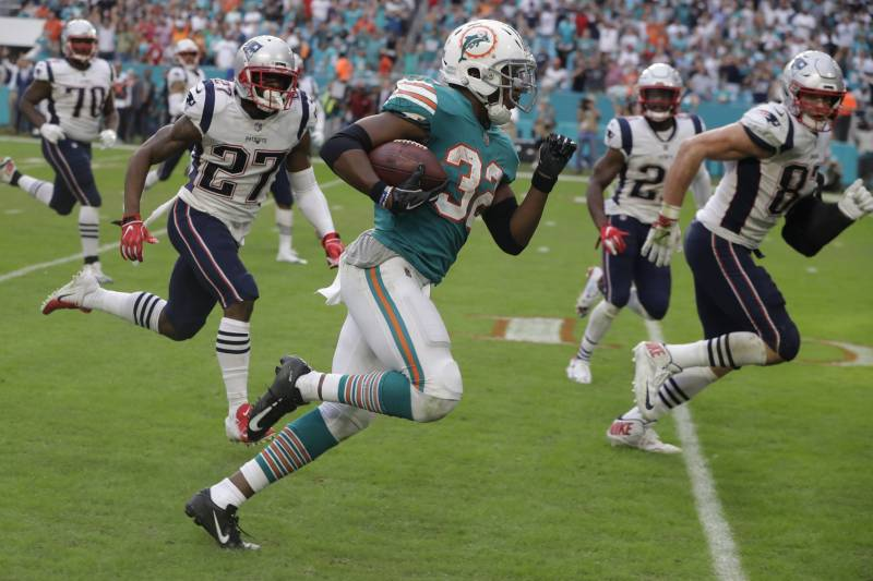 975f45ef069 Look  Dolphins Unveil Throwback Uniforms to Be Worn vs. Patriots in Week 2