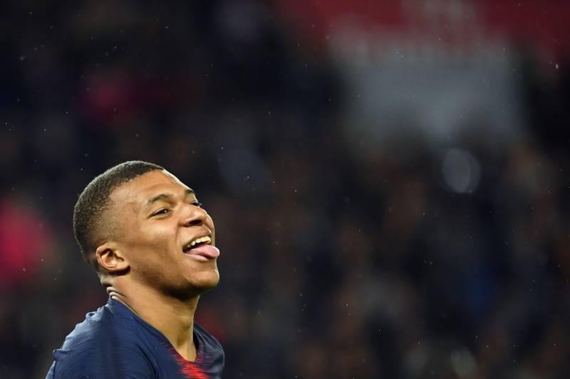 c2456023 Paris Saint-Germain's French forward Kylian Mbappe celebrates after scoring  a goal a goal during