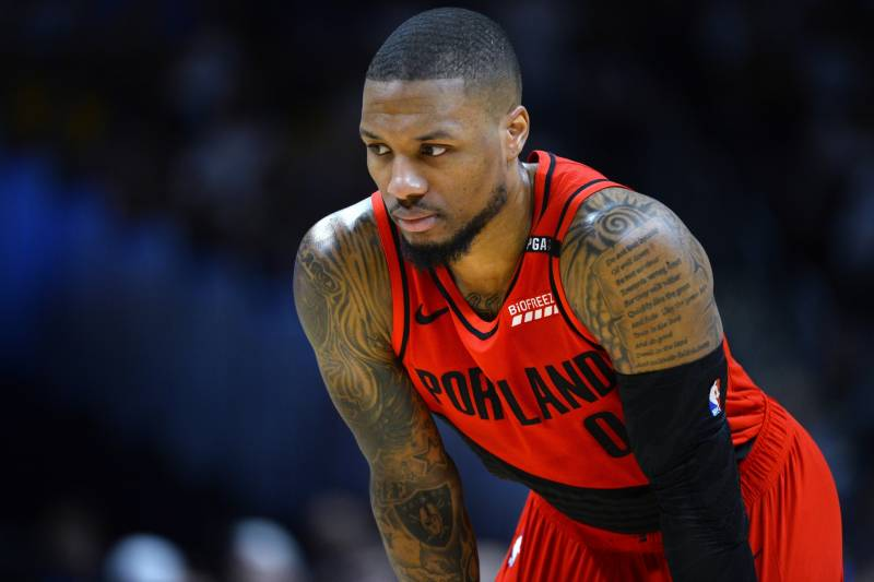 new styles 49659 2be49 Portland Trail Blazers guard Damian Lillard looks on during a foul shot in  the first half
