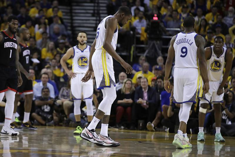 c7b99803 Golden State Warriors' Kevin Durant, center, limps off the court during the  second