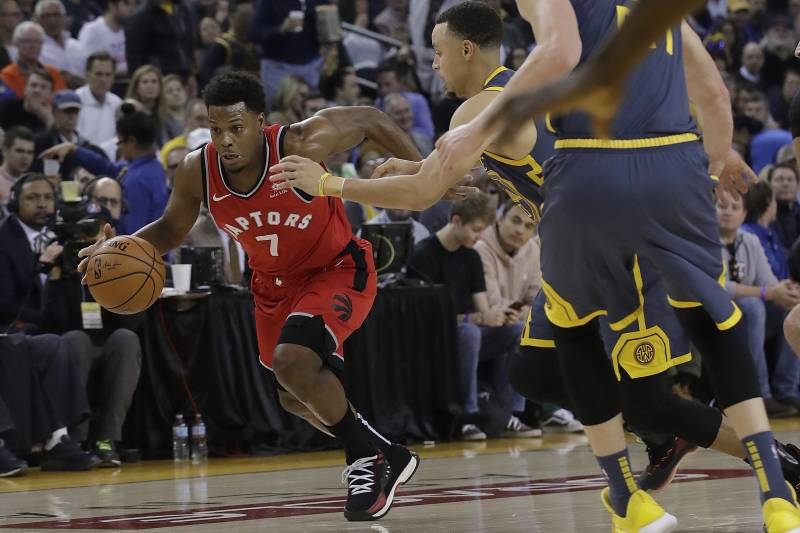 19377f997 Toronto Raptors guard Kyle Lowry (7) drives to the basket against Golden  State Warriors