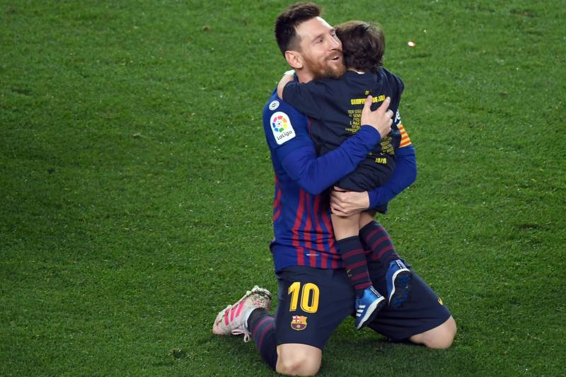 fbfce31cde7 Barcelona s Argentinian forward Lionel Messi celebrates with his son  becoming La Liga champions after winning the