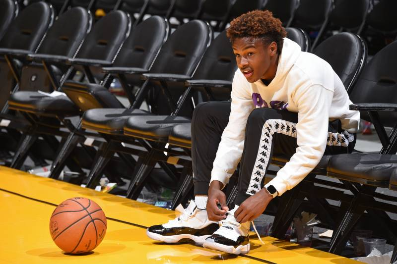 LOS ANGELES, CA - DECEMBER 28: LeBron James Jr. ties his sneakers on the court before the LA Clippers game against the Los Angeles Lakers on December 28, 2018 at STAPLES Center in Los Angeles, California. NOTE TO USER: User expressly acknowledges and agrees that, by downloading and/or using this photograph, user is consenting to the terms and conditions of the Getty Images License Agreement.