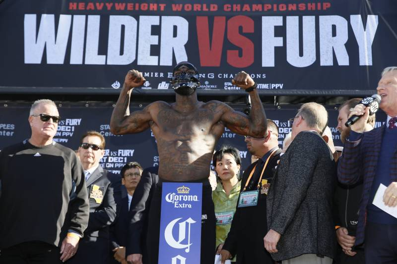 WBC heavyweight titleholder boxer Deontay Wilder wears a mask during his official weigh-in ceremony Friday, Nov. 30, 2018, at Staples Center in Los Angeles, ahead of his bout against boxer Tyson Fury. (AP Photo/Damian Dovarganes)