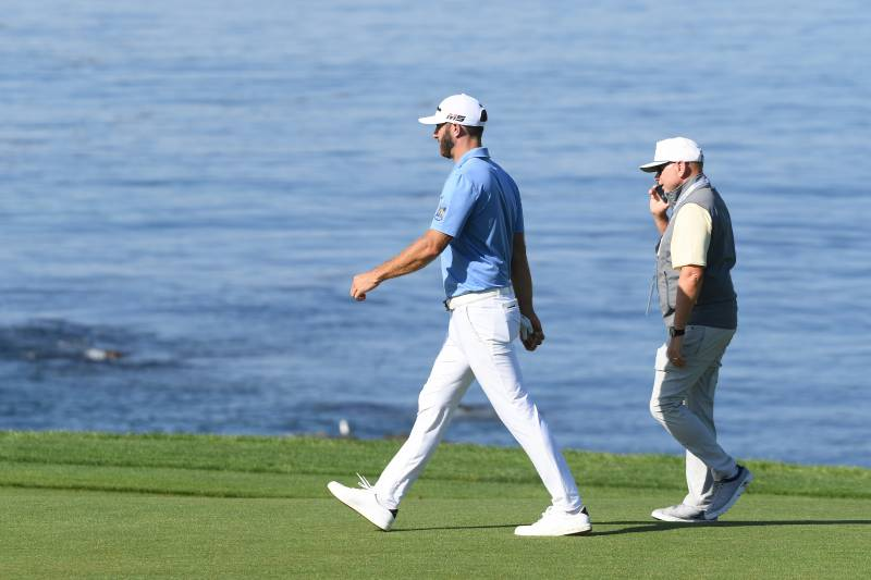 PEBBLE BEACH, CALIFORNIA - JUNE 11: Dustin Johnson of the United States (L) and player manager, David Winkle, walk off during a practice round prior to the 2019 U.S. Open at Pebble Beach Golf Links on June 11, 2019 in Pebble Beach, California. (Photo by Harry How/Getty Images)