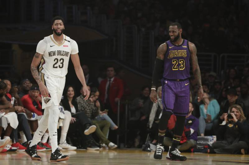 Los Angeles Lakers' LeBron James, right, New Orleans Pelicans' Anthony Davis share a light moment during the first half of an NBA basketball game, Friday, Dec. 21, 2018, in Los Angeles. (AP Photo/Jae C. Hong)