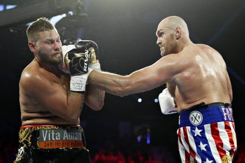 Tyson Fury Defeats Tom Schwarz Via 2nd Round Tko Retains