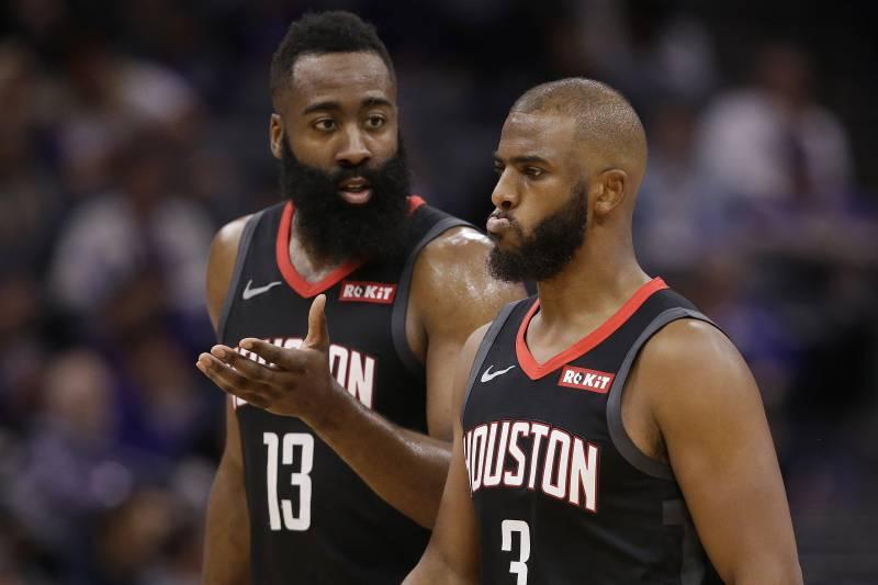 4bebf66482a Houston Rockets guard James Harden, left, talks with teammate Chris Paul as  they walk