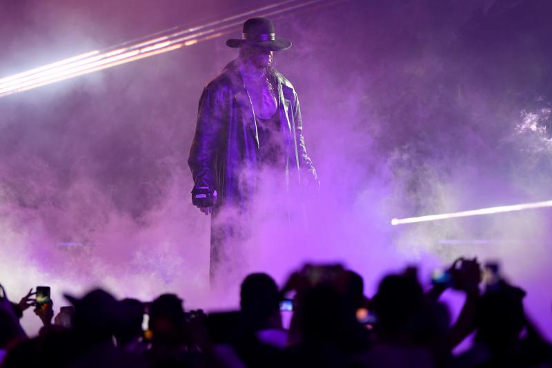 Watch Undertaker Chokeslam Shane McMahon to Save Roman Reigns in WWE Raw Return