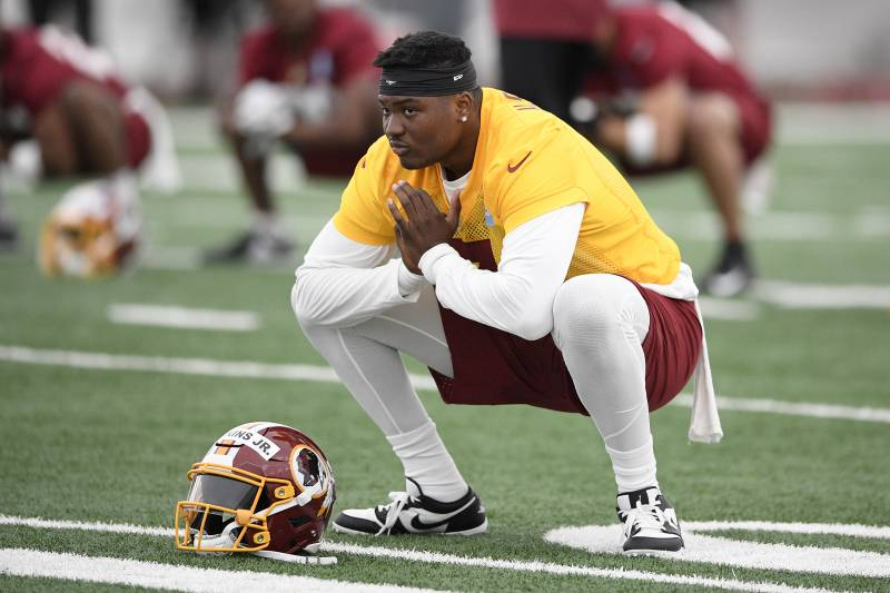 Washington Redskins quarterback Dwayne Haskins Jr. stretches during an NFL football rookie camp, Saturday, May 11, 2019, in Ashburn, Va. (AP Photo/Nick Wass)