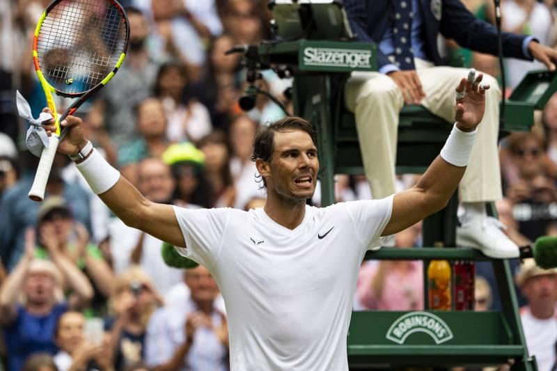 The Latest: Djokovic Beats Federer in Wimbledon Final - Bloomberg