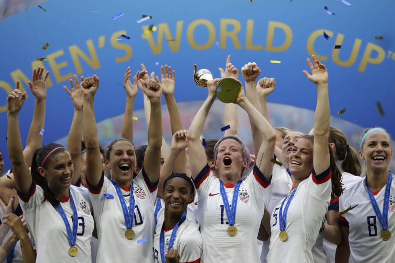 united states megan rapinoe lifts up a trophy after winning the women s world cup final