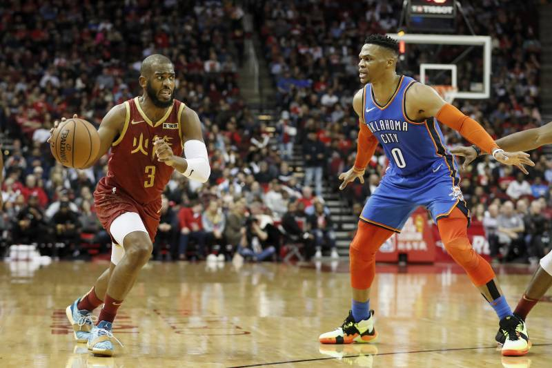 HOUSTON, TX - FEBRUARY 09:  Chris Paul #3 of the Houston Rockets drives to the basket defended by Russell Westbrook #0 of the Oklahoma City Thunder in the first half at Toyota Center on February 9, 2019 in Houston, Texas. NOTE TO USER: User expressly acknowledges and agrees that, by downloading and or using this photograph, User is consenting to the terms and conditions of the Getty Images License Agreement.