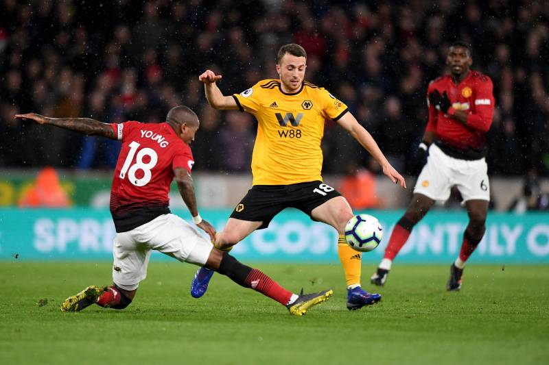 WOLVERHAMPTON, ENGLAND - APRIL 02: Ashley Young of Manchester United and Diogo Jota of Wolverhampton Wanderers during the Premier League match between Wolverhampton Wanderers and Manchester United at Molineux on April 2, 2019 in Wolverhampton, United Kingdom. (Photo by Sam Bagnall - AMA/Getty Images)