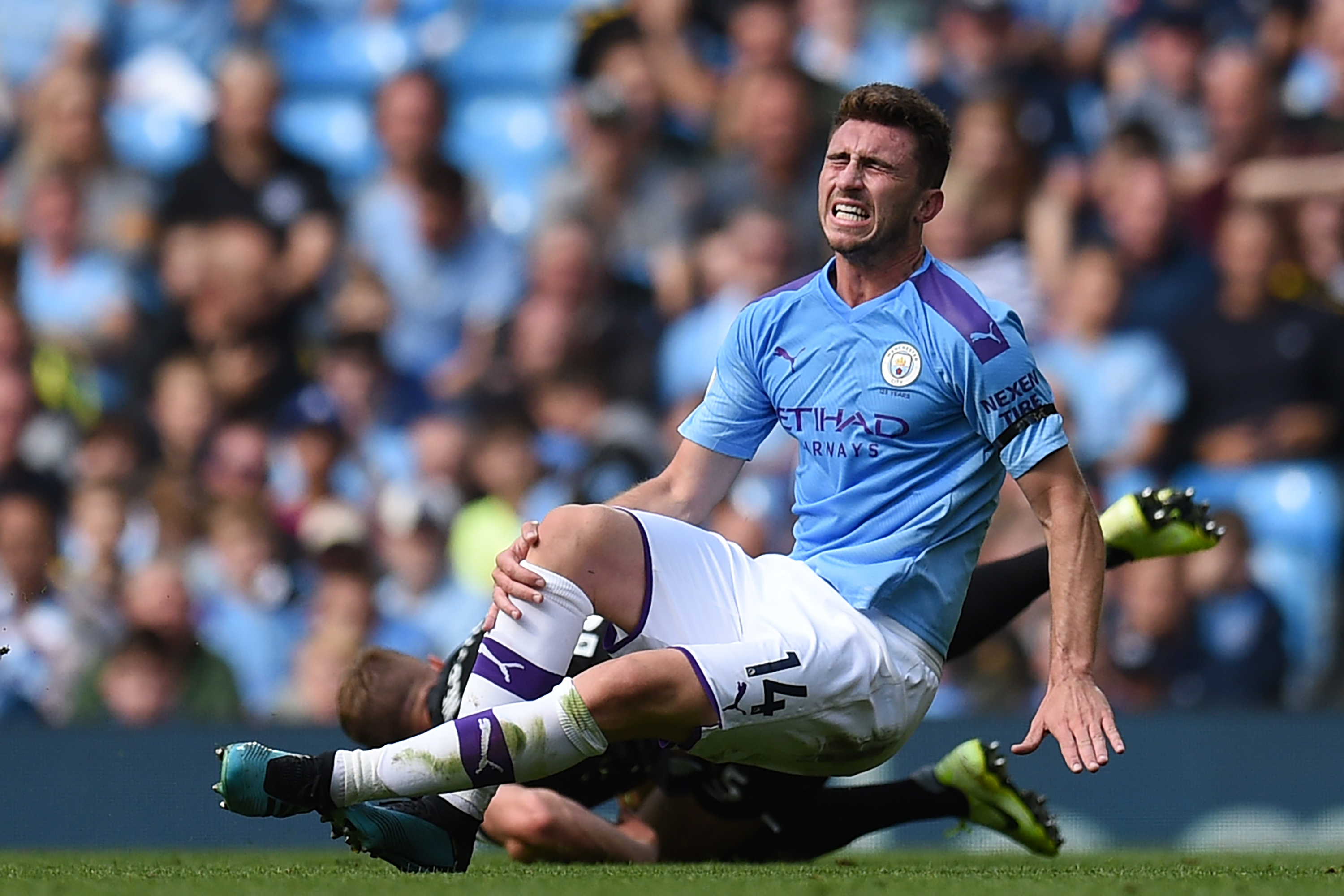 Laporte Going down after sustaining a knee injury Vs Brighton on August 31 2019