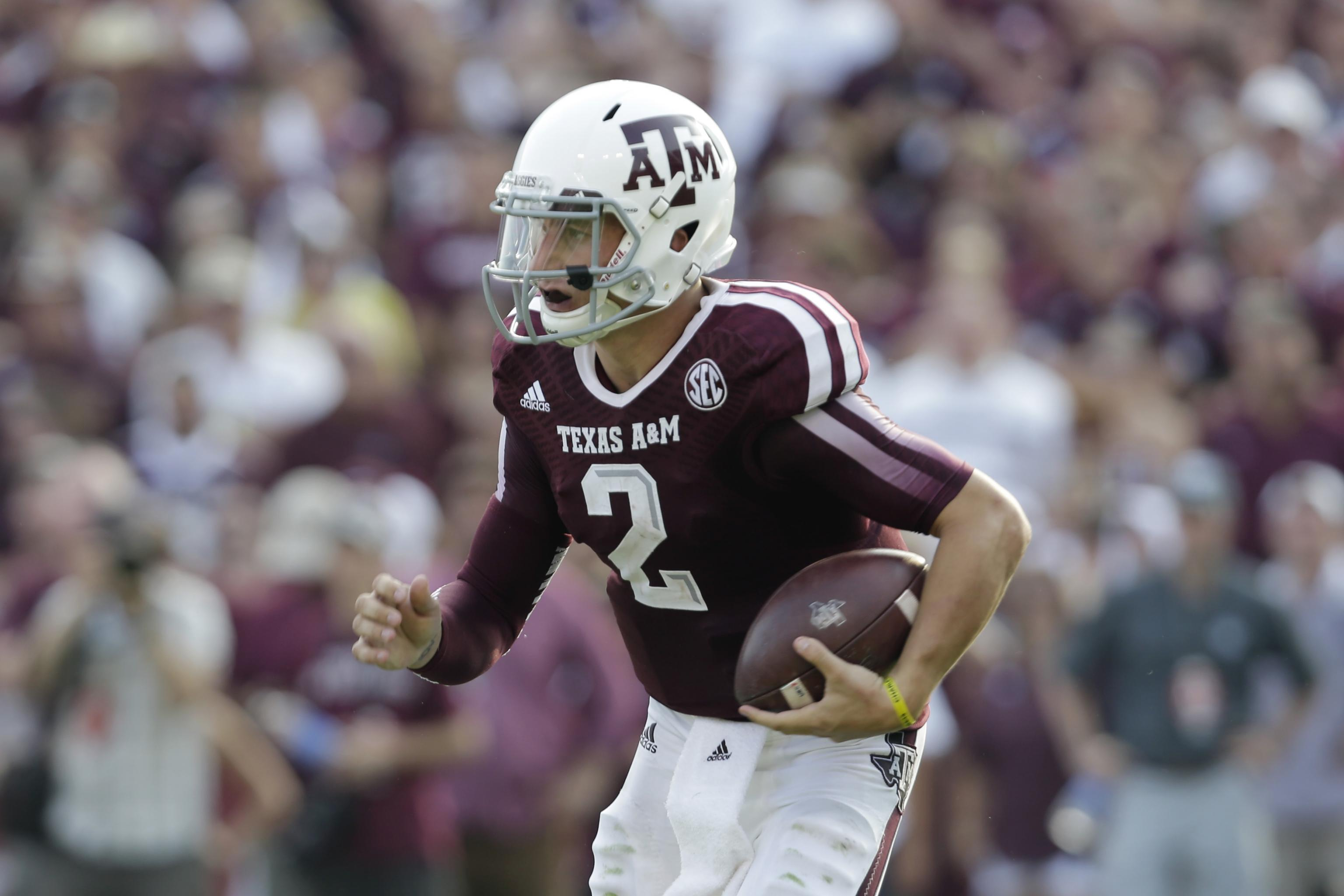 official photos b76ae 12138 Johnny Manziel's Texas A&M Jersey Stolen from School's Hall ...