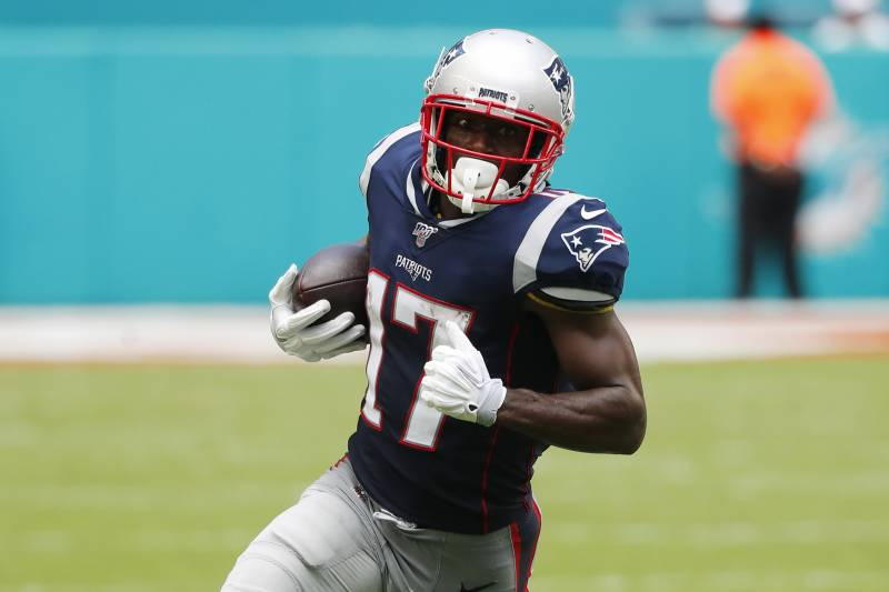 New England Patriots wide receiver Antonio Brown (17) runs the ball, during the first half at an NFL football game against the Miami Dolphins, Sunday, Sept. 15, 2019, in Miami Gardens, Fla. (AP Photo/Wilfredo Lee)