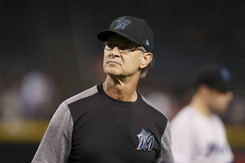Miami Marlins manager Don Mattingly walks off the field after replacing a pitcher during the seventh inning of a baseball game against the Arizona Diamondbacks Monday, Sept. 16, 2019, in Phoenix. (AP Photo/Ross D. Franklin)