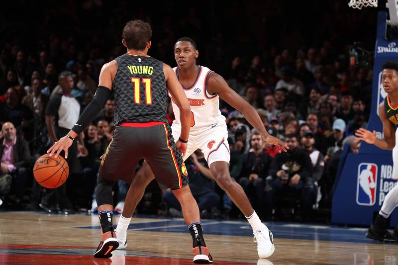 NEW YORK, NY - OCTOBER 16: RJ Barrett #9 of the New York Knicks plays defense against Trae Young #11 of the Atlanta Hawks during a pre-season game on October 16, 2019 at Madison Square Garden in New York City, New York. NOTE TO USER: User expressly acknowledges and agrees that, by downloading and or using this photograph, User is consenting to the terms and conditions of the Getty Images License Agreement. Mandatory Copyright Notice: Copyright 2019 NBAE (Photo by Nathaniel S. Butler/NBAE via Getty Images)