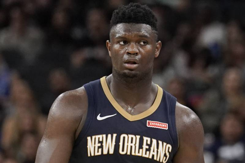New Orleans Pelicans' Zion Williamson walks upcourt during the second half of an NBA preseason basketball game against the San Antonio Spurs, Sunday, Oct. 13, 2019, in San Antonio. (AP Photo/Darren Abate)