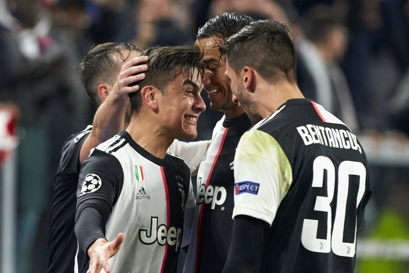 TURIN, ITALY - NOVEMBER 26: Paulo Dybala of Juventus celebrates after scoring his team's first goal wit¡h his teammates during the UEFA Champions League group D match between Juventus and Atletico Madrid at Allianz Stadium on November 26, 2019 in Turin, Italy. (Photo by Quality Sport Images/Getty Images)