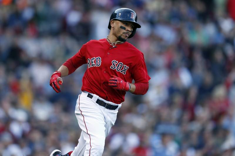 Boston Red Sox's Mookie Betts runs on his RBI single during the third inning of a baseball game against the Baltimore Orioles in Boston, Sunday, Sept. 29, 2019. (AP Photo/Michael Dwyer)