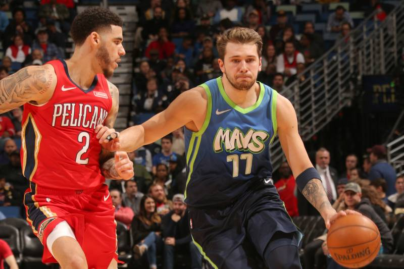 NEW ORLEANS, LA - DECEMBER 3: Luka Doncic #77 of the Dallas Mavericks handles the ball against the New Orleans Pelicans on December 3, 2019 at the Smoothie King Center in New Orleans, Louisiana. NOTE TO USER: User expressly acknowledges and agrees that, by downloading and or using this Photograph, user is consenting to the terms and conditions of the Getty Images License Agreement. Mandatory Copyright Notice: Copyright 2019 NBAE (Photo by Layne Murdoch Jr./NBAE via Getty Images)