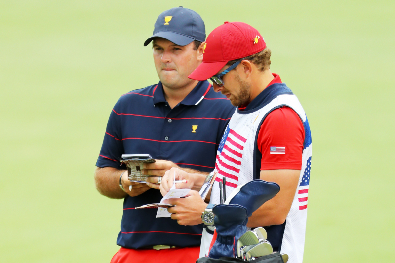 Patrick Reed's Caddie Kessler Karain Has Altercation with Fan at Presidents Cup