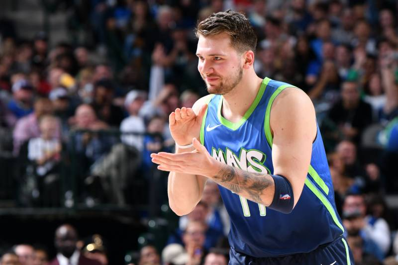 DALLAS, TX - DECEMBER 26: Luka Doncic #77 of the Dallas Mavericks reacts to play against the San Antonio Spurs on December 26, 2019 at the American Airlines Center in Dallas, Texas. NOTE TO USER: User expressly acknowledges and agrees that, by downloading and or using this photograph, User is consenting to the terms and conditions of the Getty Images License Agreement. Mandatory Copyright Notice: Copyright 2019 NBAE (Photo by Glenn James/NBAE via Getty Images)