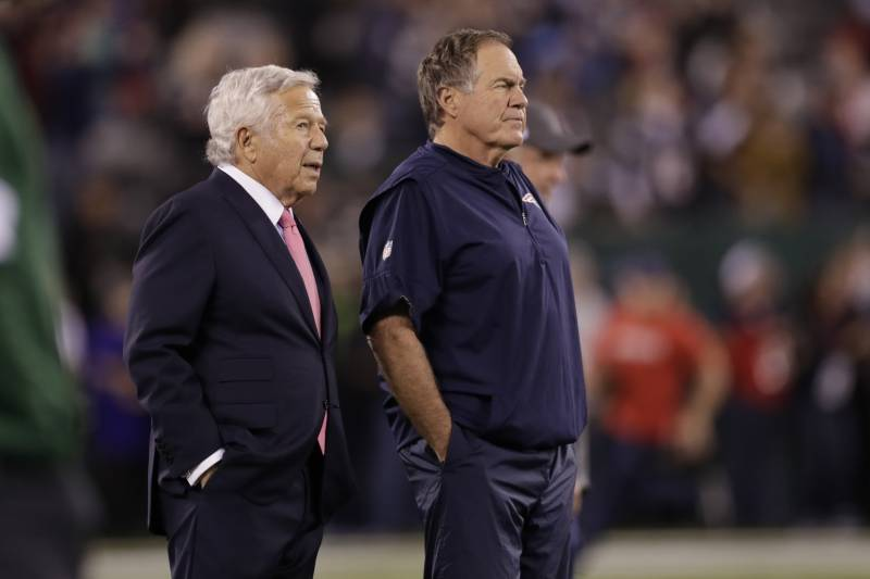 New England Patriots owner Robert Kraft, left, talks to head coach Bill Belichick as their team warms up before an NFL football game against the New York Jets Monday, Oct. 21, 2019, in East Rutherford, N.J. (AP Photo/Adam Hunger)