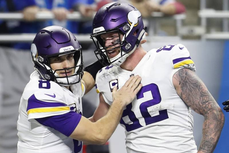Minnesota Vikings quarterback Kirk Cousins (8) pats tight end Kyle Rudolph (82) after Rudolph scored a touch down during the second half of an NFL football game against the Detroit Lions, Sunday, Dec. 23, 2018, in Detroit. (AP Photo/Rey Del Rio)