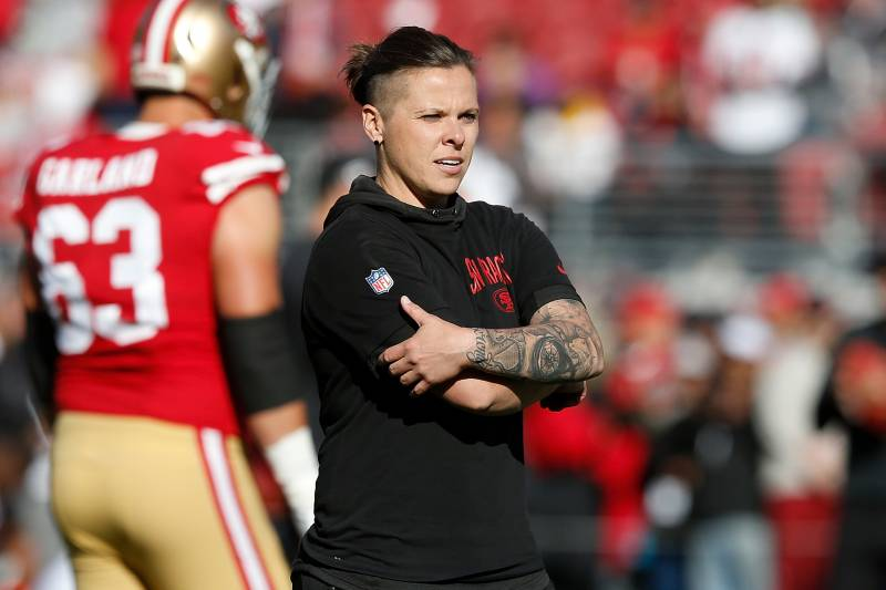SANTA CLARA, CALIFORNIA - DECEMBER 15: San Francisco 49ers offensive assistant coach Katie Sowers looks on during the warm up before the game against the Atlanta Falcons at Levi's Stadium on December 15, 2019 in Santa Clara, California. (Photo by Lachlan Cunningham/Getty Images)