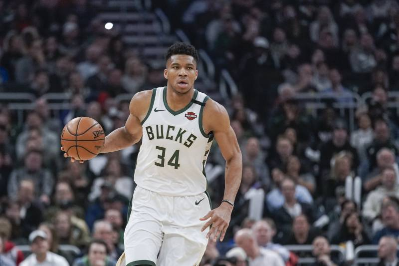 Milwaukee Bucks' Giannis Antetokounmpo dribbles during the first half of an NBA basketball game against the Boston Celtics Thursday, Jan. 16, 2020, in Milwaukee. (AP Photo/Morry Gash)