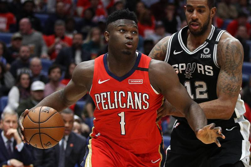 NEW ORLEANS, LOUISIANA - JANUARY 22: Zion Williamson #1 of the New Orleans Pelicans drives the ball around LaMarcus Aldridge #12 of the San Antonio Spurs at Smoothie King Center on January 22, 2020 in New Orleans, Louisiana. NOTE TO USER: User expressly acknowledges and agrees that, by downloading and/or using this photograph, user is consenting to the terms and conditions of the Getty Images License Agreement.   (Photo by Chris Graythen/Getty Images)