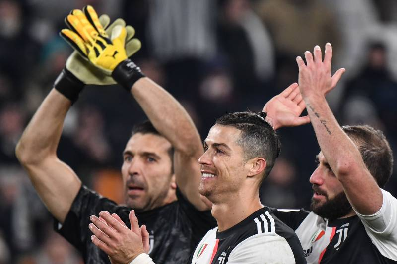 TOPSHOT - (From L) Juventus' Italian goalkeeper Gianluigi Buffon, Juventus' Portuguese forward Cristiano Ronaldo and Juventus' Argentinian forward Gonzalo Higuain acknowledge the public at the end of the Italian Cup (Coppa Italia) round of 8 football match Juventus vs AS Roma on January 22, 2020 at the Juventus stadium in Turin. (Photo by Marco Bertorello / AFP) (Photo by MARCO BERTORELLO/AFP via Getty Images)