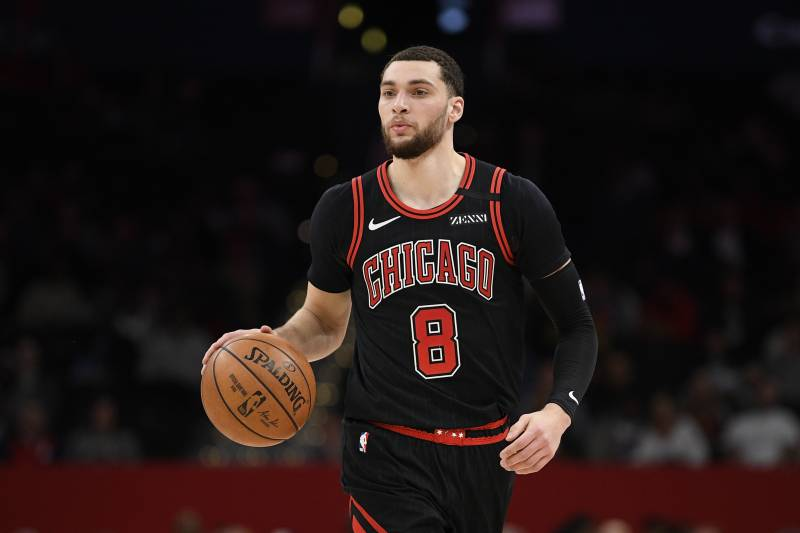 Chicago Bulls guard Zach LaVine (8) dribbles the ball during the first half of an NBA basketball game against the Washington Wizards, Tuesday, Feb. 11, 2020, in Washington. (AP Photo/Nick Wass)