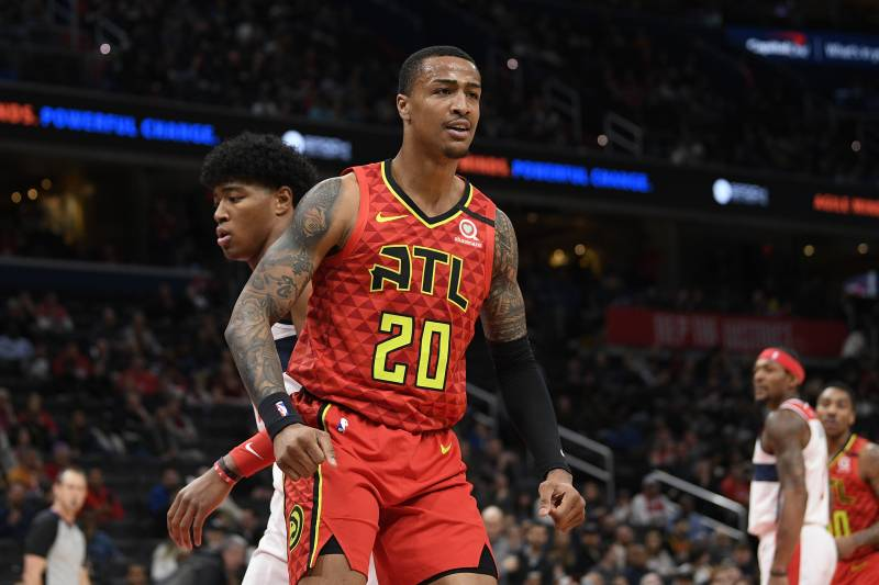 Atlanta Hawks forward John Collins (20) reacts during the first half of an NBA basketball game against the Washington Wizards, Friday, March 6, 2020, in Washington. (AP Photo/Nick Wass)
