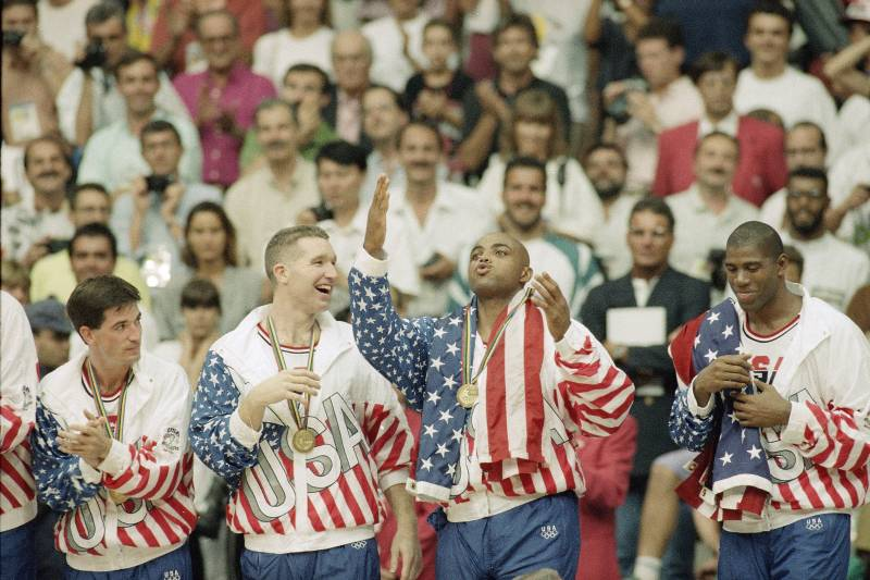 From left the USA's John Stockton, Chris Mullin, and Charles Barkley rejoice with their gold medals after beating Croatia, 117-85 in Olympics basketball in Barcelona Saturday, Aug. 8, 1992. The USA beat Croatia 117-85 to win the gold medal. (AP Photo/John Gaps III)