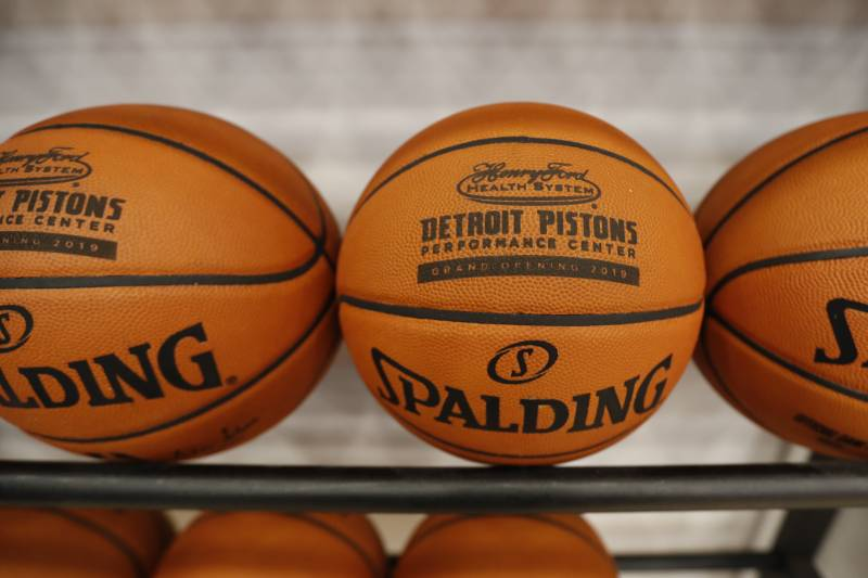 Basketballs sporting the Henry Ford Detroit Pistons Performance Center logo are displayed Monday, Oct. 7, 2019, in Detroit. The $90 million center includes a sports medicine, treatment and rehab facility managed by the Henry Ford Health System, as well as retail and public spaces. (AP Photo/Carlos Osorio)