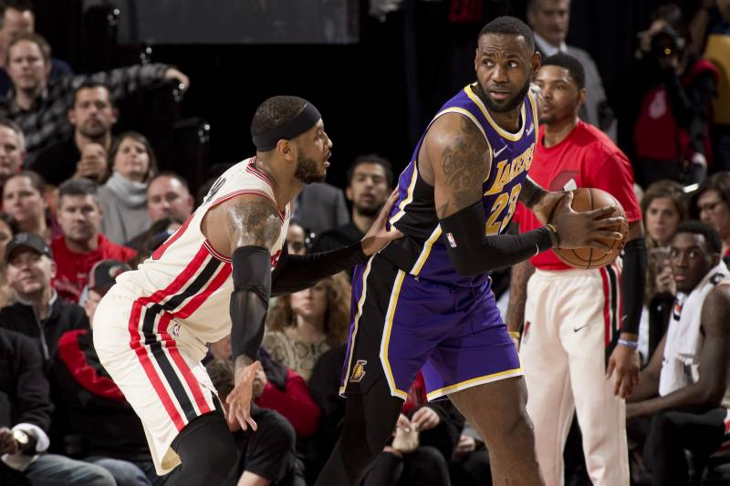 """PORTLAND OR - DECEMBER 28: LeBron James # 23 of the Los Angeles Lakers dribbles the ball while being guarded by Carmelo Anthony # 00 of the Portland Trail Blazers on December 28, 2019 at Moda Center Arena in Portland, Oregon. NOTICE TO THE USER: The user expressly acknowledges and agrees that by downloading and / or using this photo the user agrees to the terms of the Getty Images license agreement. Mandatory Copyright Notice: Copyright 201<div class=""""e3lan e3lan-in-post1""""><script async src=""""//pagead2.googlesyndication.com/pagead/js/adsbygoogle.js""""></script> <!-- Text_Display_Ad --> <ins class=""""adsbygoogle""""      style=""""display:block""""      data-ad-client=""""ca-pub-7542518979287585""""      data-ad-slot=""""2196042218""""      data-ad-format=""""auto""""></ins> <script> (adsbygoogle = window.adsbygoogle 