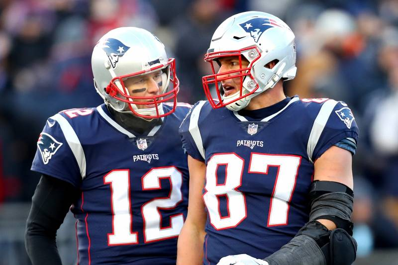 FOXBOROUGH, MASSACHUSETTS - JANUARY 13: Tom Brady #12 of the New England Patriots reacts with Rob Gronkowski #87 during the third quarter in the AFC Divisional Playoff Game against the Los Angeles Chargers at Gillette Stadium on January 13, 2019 in Foxborough, Massachusetts. (Photo by Maddie Meyer/Getty Images)