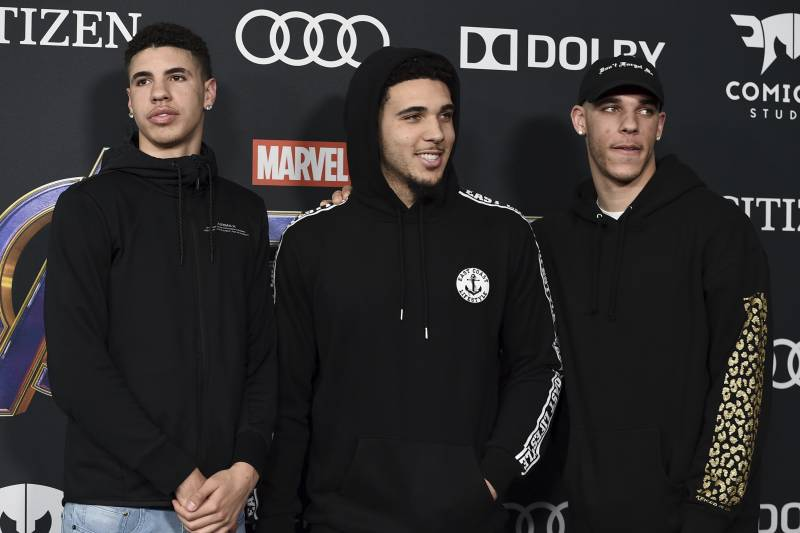 Professional basketball player Lonzo Ball, of the Los Angeles Lakers, from right, and his brothers LiAngelo Ball and LaMelo Ball arrive at the premiere of