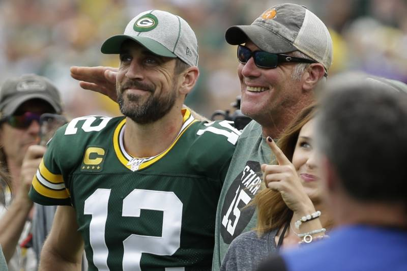 Green Bay Packers' Aaron Rodgers smiles with former quarterback Brett Favre during halftime of an NFL football game against the Minnesota Vikings Sunday, Sept. 15, 2019, in Green Bay, Wis. (AP Photo/Mike Roemer)