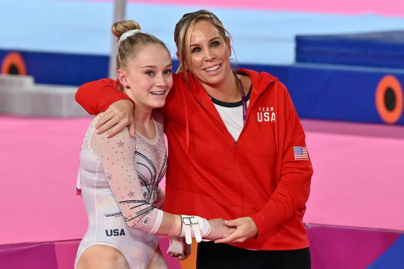 US Riley McCusker (L) is hugged by her coach Maggie Haney after making her routine in the Artistic Gymnastics Women's Uneven Bars Final to win the gold medal during the Lima 2019 Pan-American Games in Lima, on July 30, 2019. (Photo by Luis ROBAYO / AFP)        (Photo credit should read LUIS ROBAYO/AFP via Getty Images)