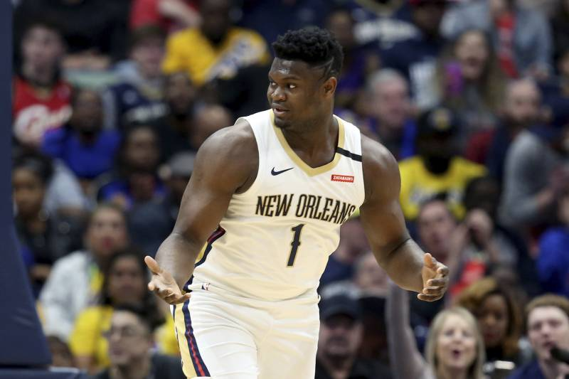 New Orleans Pelicans forward Zion Williamson (1) responds after a basket during the first half of an NBA basketball game in New Orleans, Sunday, March 1, 2020. (AP Photo / Rusty Costanza)