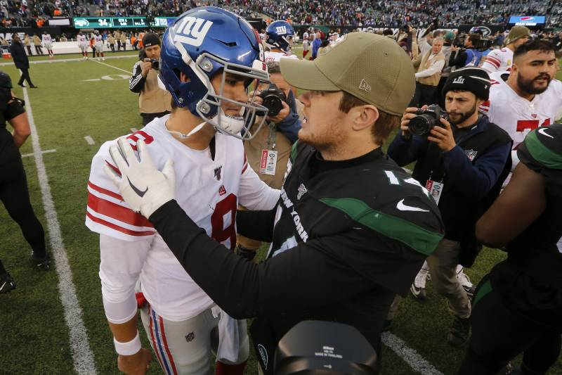 EAST RUTHERFORD, NEW JERSEY - NOVEMBER 10:   (NEW YORK DAILIES OUT)   Daniel Jones #8 of the New York Giants and Sam Darnold #14 of the New York Jets meet after their game at MetLife Stadium on November 10, 2019 in East Rutherford, New Jersey. The Jets defeated the Giants 34-27. (Photo by Jim McIsaac/Getty Images)