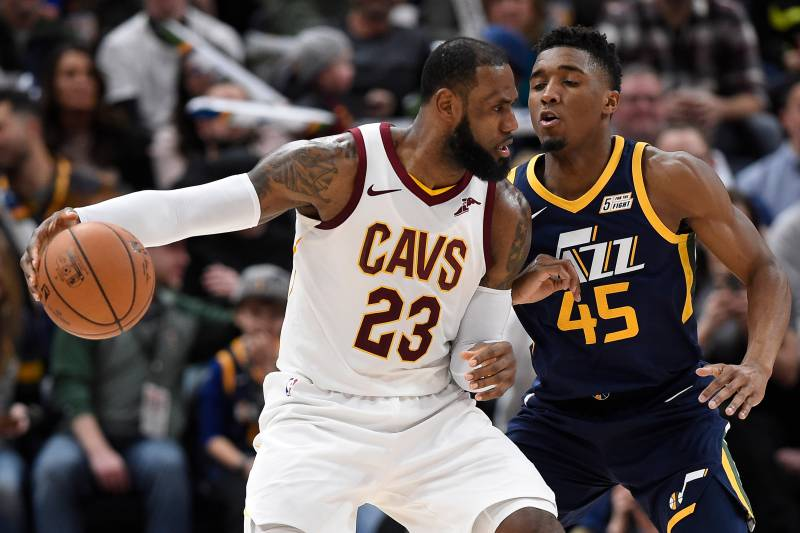 SALT LAKE CITY, UT - DECEMBER 30: LeBron James #23 of the Cleveland Cavaliers is defended by Donovan Mitchell #45 of the Utah Jazz in the second half of the 104-101 win by the Utah Jazz at Vivint Smart Home Arena on December 30, 2017 in Salt Lake City, Utah. NOTE TO USER: User expressly acknowledges and agrees that, by downloading and or using this photograph, User is consenting to the terms and conditions of the Getty Images License Agreement. (Photo by Gene Sweeney Jr./Getty Images)
