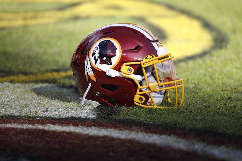 Washington Redskins helmets sits on the field before the start of an NFL football game between the Washington Redskins and the Philadelphia Eagles, Sunday, Dec. 15, 2019, in Landover, Md. (AP Photo/Patrick Semansky)